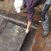 Stuart demonstrates a pit in barrow 4